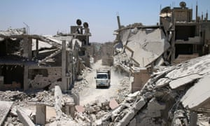 A truck drives down a destroyed street in a rebel-held area of Deraa in July 2017. The Syrian regime retook the province from rebels in July 2018.