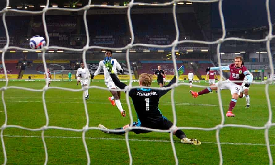 A behind the net photo of Burnley's Matej Vydra, on the right of the picture, beating Kasper Scheichel with a shot to score the opening goal at Turf Moor.