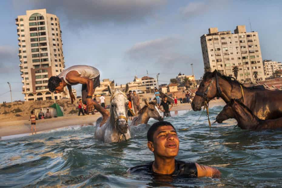 Teenagers swimming on the beach at Gaza