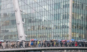 Morning rush hour at Canary Wharf, where many London-based banks have their headquarters.