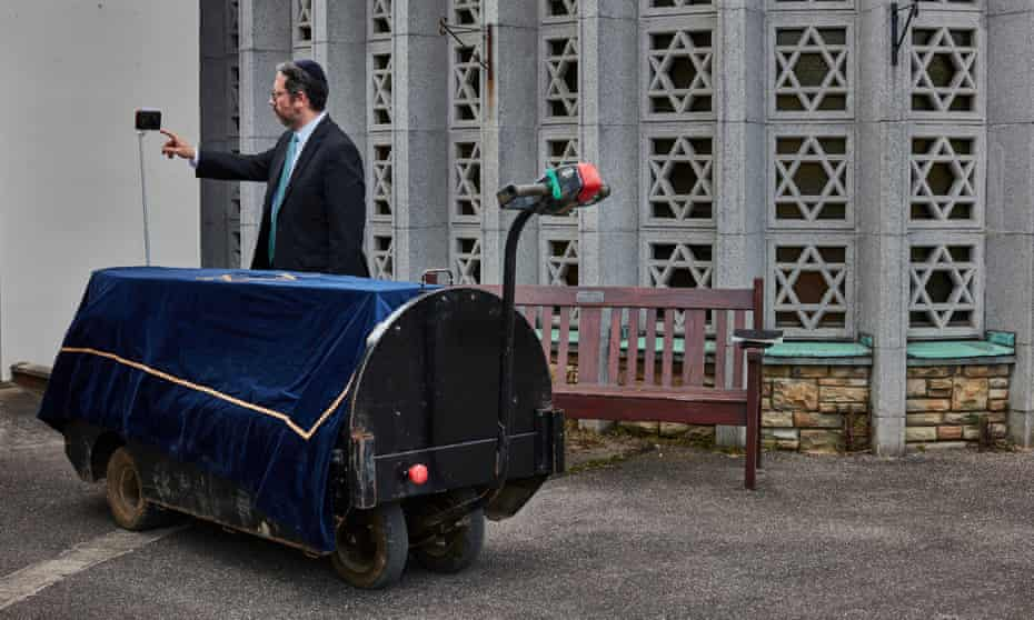7 May: Rabbi Daniel Epstein conducts a funeral at a Jewish cemetery in Waltham Abbey for a victim of Covid-19, broadcast via Zoom