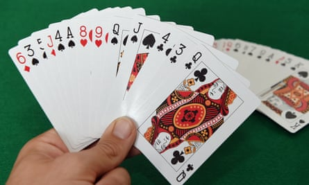 A player holding a selection of playing cards