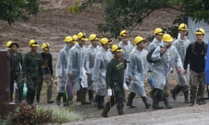 Rescue workers walk toward the cave entrance in Mae Sai, Chiang Rai province, on Tuesday. Photograph: Sakchai Lalit/AP