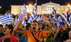 Anti-austerity protesters celebrate in front of the Greek parliament in Syntagma Square, Athens on 5 July 2015