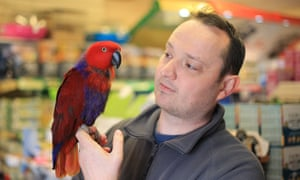 Strabane pet store owner Andrew Montgomery with Peppa the Parrot