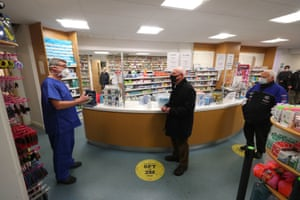 Pharmacist Andrew Hodgson speaking to Robert Salt, 82, before he receives an injection of the coronavirus vaccine this morning at Andrews Pharmacy in Macclesfield.