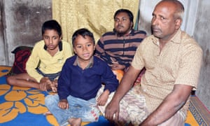 Fruit vendor Tofazzal Hossain with his two sons and grandson (second left) who have Duchenne muscular dystrophy. 'They are suffering and have no hope of recovery,' said Hossain.
