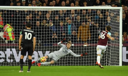 Mark Noble sends Wayne Hennessey the wrong way.