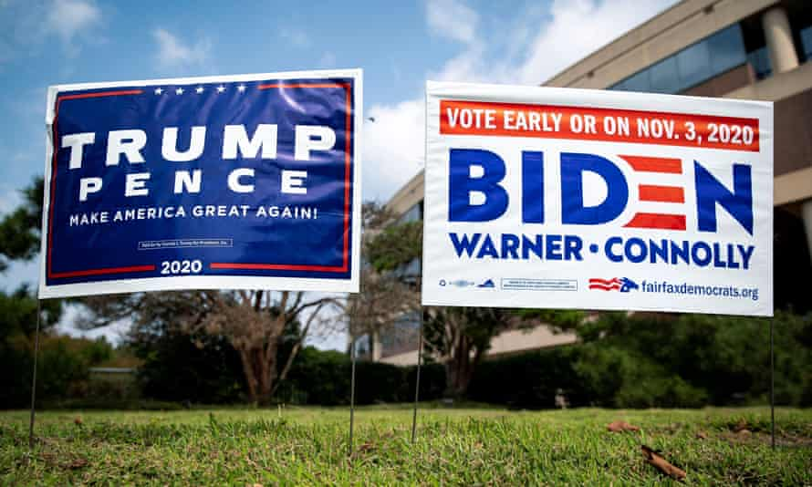 Yard signs supporting Donald Trump and Democratic Joe Biden are seen outside of an early voting site at the Fairfax County Government Center in Fairfax, Virginia.