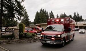 An ambulance transports a patient from the Life Care Center of Kirkland, the long-term care facility linked to two of the three confirmed coronavirus cases in the state, in Kirkland, Washington, US.