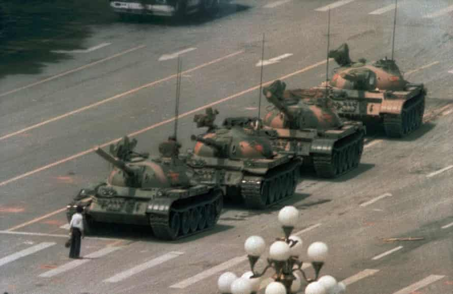 A man stands alone in front of a line of tanks heading east on Beijing's Changan Blvd in Tiananmen Square, Beijing.