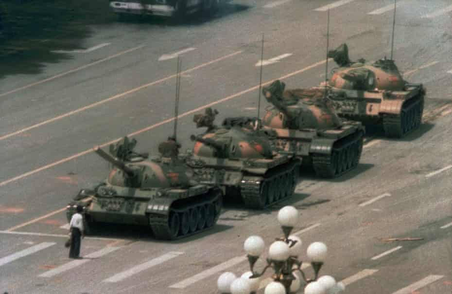 """""""Tank man"""" is often used to describe an unidentified person famously pictured standing before tanks in China's Tiananmen Square during pro-democracy demonstrations in June 1989."""