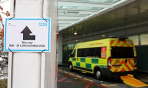 A sign directs patients towards an NHS coronavirus pod at University College hospital in London.