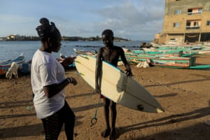 Khadjou talks to a young surfer in Ngor