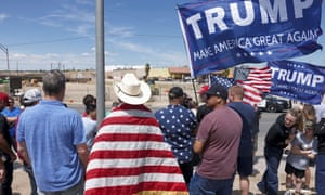 Donald Trump supporters stand near the border during a rally as Trump visits the U.S.-Mexico border in Calexico, California, on 5 April 2019.