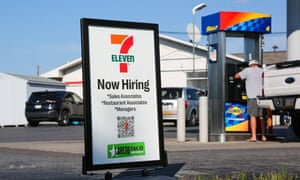 A now hiring sign at a 7-Eleven convenience store.