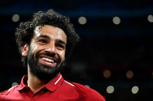 Mohamed Salah of Liverpool smiles as he celebrates victory.