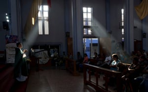 Fernando Cuevas, of the Scalabrinian Missionaries, celebrates Mass at a Catholic church in Ciudad Tecun Uman, Guatemala, on the border with Mexico.