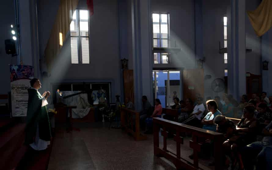 Fernando Cuevas, of the Scalabrinian Missionaries, celebrates Mass at a Catholic church in Ciudad Tecun Uman, Guatemala, on the border with Mexico.