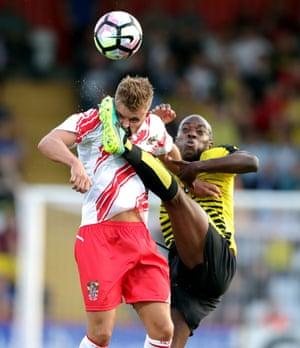 Stevenage's Matt Godden and Watford's Allan Nyom battle for the ball during a pre-season friendly at the Lamex Stadium, Stevenage.