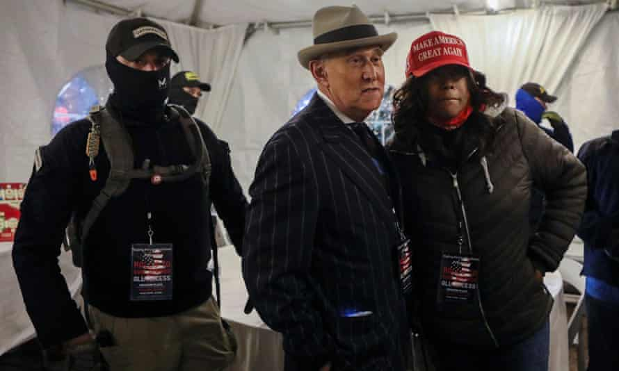 Members of the Oath Keepers provide security to Roger Stone in Washington DC on 5 January.