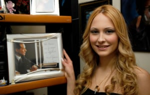 April 2009: 18-year-old Noemi Letizia poses with a portrait of Silvio Berlusconi in her home in Naples, Italy. Berlusconi's friendship with the 18-year-old prompted his wife to ask for a divorce and sparked an outcry from the opposition
