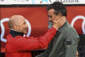 Sevilla's coach Jorge Sampaoli, left, greets Luis Enrique, his opposite number at Barcelona.