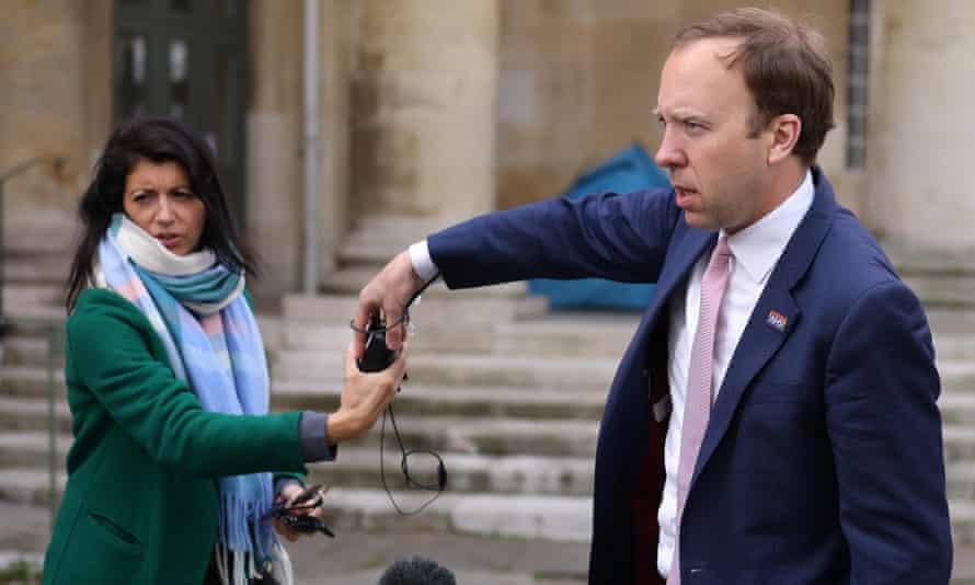 Matt Hancock hands a microphone to his aide Gina Coladangelo