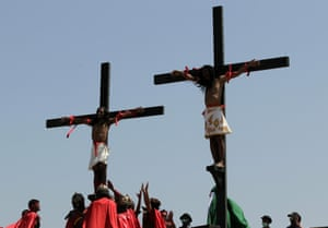 Penitents nailed to wooden crosses for the 29th year of their re-enactment in San Fernando, Philippines