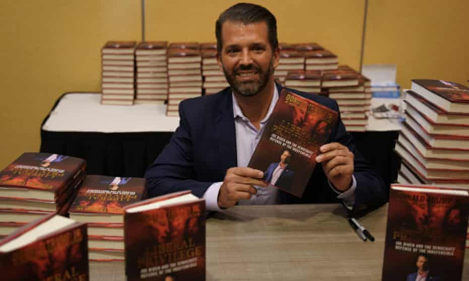 Donald Trump Jr signs books at a Marriot Hotel on Long Island.