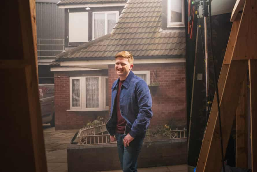 Sam Aston, who plays Chesney, waits by one of the false views that are behind every 'external' door on the interior sets.