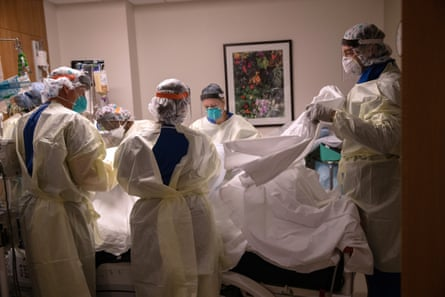 A 'prone team', wearing personal protective equipment (PPE), turns over a patient with Covid-19 in Stamford, Connecticut.