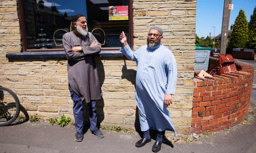 Baker Bashir Karolia, left, and Musa Kazi, in Batley where George Galloway is standing in the Batley and Spen byelection.