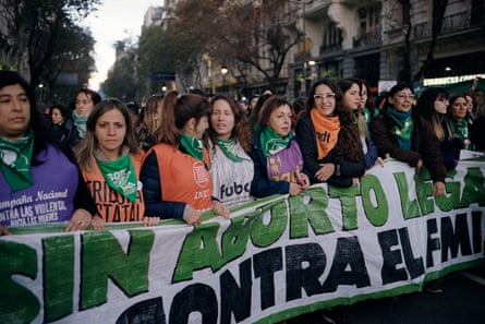 Thousands of protesters march through the streets in Buenos Aires to demand legal abortion, on 4 June.