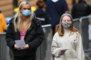 Students from the University of Glasgow walk at a pop-up testing centre for coronavirus at the Murano Street Student Village complex in Glasgow, Scotland on 24 September, 2020, as more than 120 students test positive for the virus.