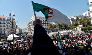 Algerians wave their national flag as they demonstrate