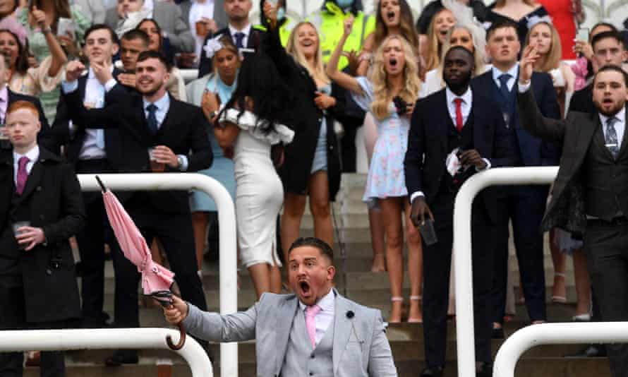 Racegoers cheer on their fancies during Oaks day at Epsom.