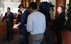 Greens leader Richard Di Natalie watches environment minister Josh Frydenberg at a press conference