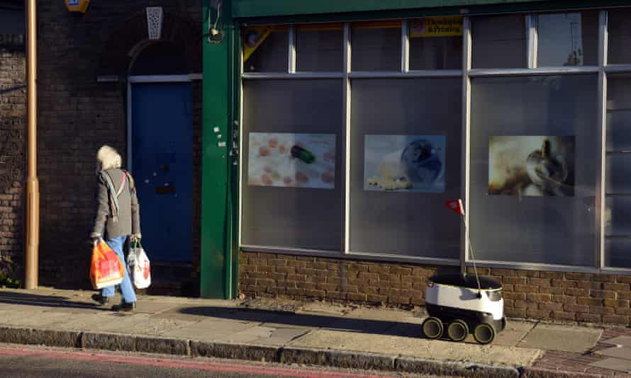 A robot delivering food for online ordering service Just Eat, on the street in Greenwich, London.