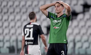 Mattia Caldara of Atalanta looks dejected during the 2-2 draw with Juventus at the Alianz Arena.
