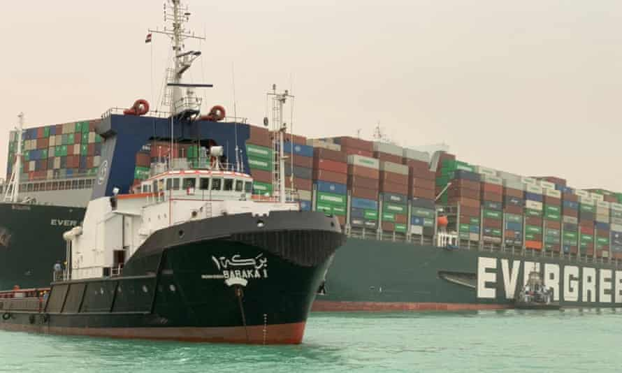 Taiwan-owned MV Ever Given (Evergreen), a 400-metre- (1,300-foot-)long and 59-metre wide vessel, lodged sideways and impeding all traffic across the waterway of Egypt's Suez Canal.