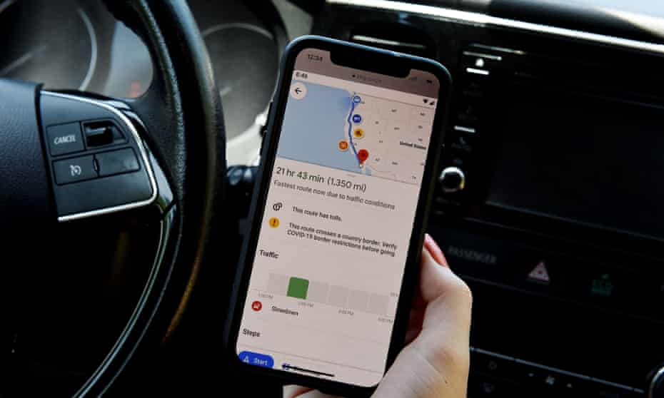 Driver uses Google Maps during a ride