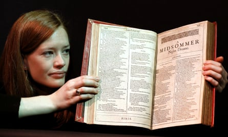 A member of Christie's staff holds a copy of Shakespeare's first folio, which sold for £1.87m.