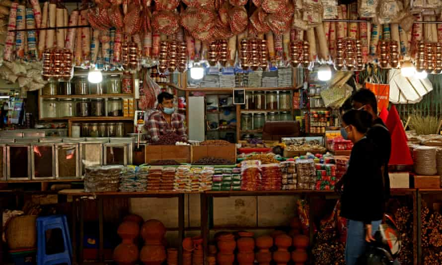 A shopkeeper in Bangalore waits for customers after being allowed to reopen after a Covid shutdown.