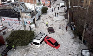 Vehicles buried in hail are seen in the streets in the eastern area of Guadalajara
