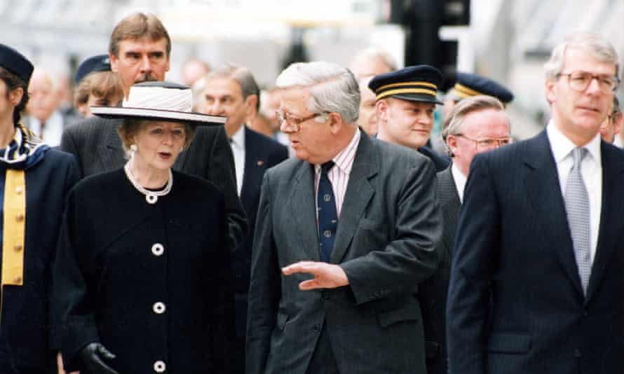 Howe (centre) with Margaret Thatcher and John Major, opening the Channel tunnel in 1994.