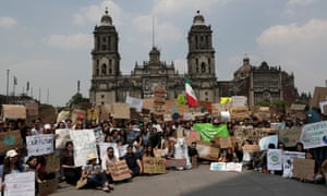 Students pose in front of Metropolitan Cathedral at the main square Zocalo, before they take part in a march demanding action on climate change, in Mexico City, Mexico.