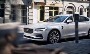 A Volvo S90 plug-in hybrid at a charging point
