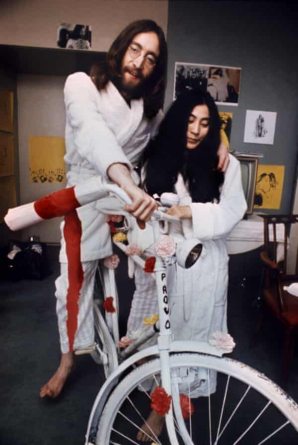 """John Lennon and Yoko Ono (L) with a """"Provo"""" bike in Amsterdam in 1969."""