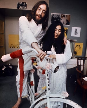 John Lennon and Yoko Ono with a white bicycle during their visit to Amsterdam in 1969.